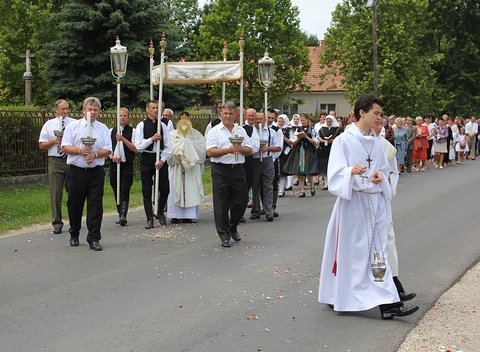 Priest and assistants carrying the monstrance in Corpus Christi procession in Galgaheviz, Hungary.